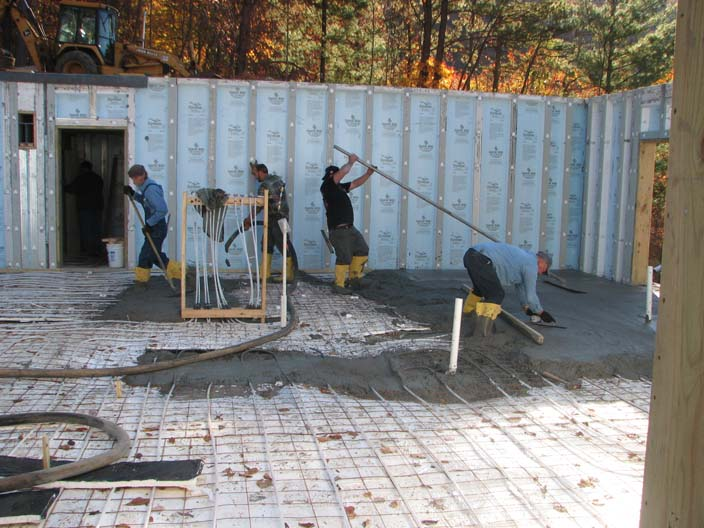 Pouring concrete on The Barrier insulation